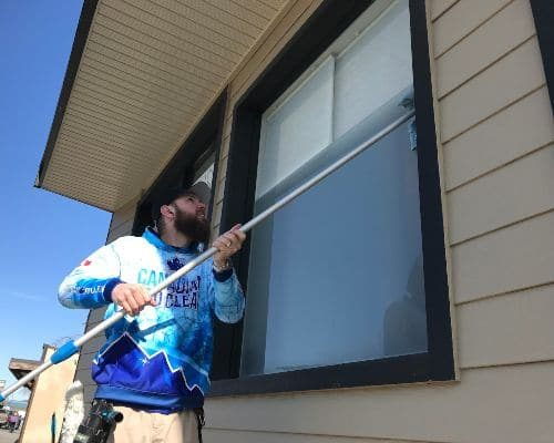 cleaning a residential window in Chilliwack
