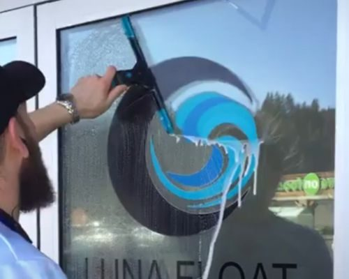 Window cleaning at a local Luna Float spa center