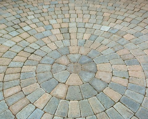 Spiral paver stones before cleaning and re-sanding.